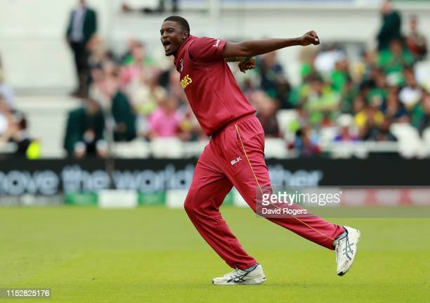 Jason Holder, the West Indies captain, celebrates after taking the wicket of Imad Wasim during the Group Stage match of the ICC Cricket World Cup...