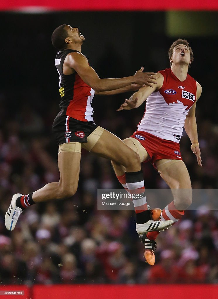 Jason Holmes of the Saints (L) and Mike Pyke of the Swans compete for the ball during the round 22 AFL match between the St Kilda Saints and the Sydney Swans at Etihad Stadium on August 30, 2015 in Melbourne, Australia. Holmes is the first born and raised American to play and Pyke is the first Canadian to play.