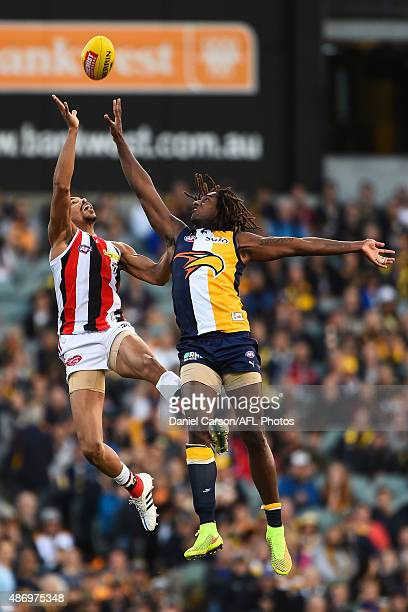Jason Holmes of the St Kilda Saints contests a ruck with Nic Naitanui of the West Coast Eagles during the 2015 AFL round 23 match between the West...