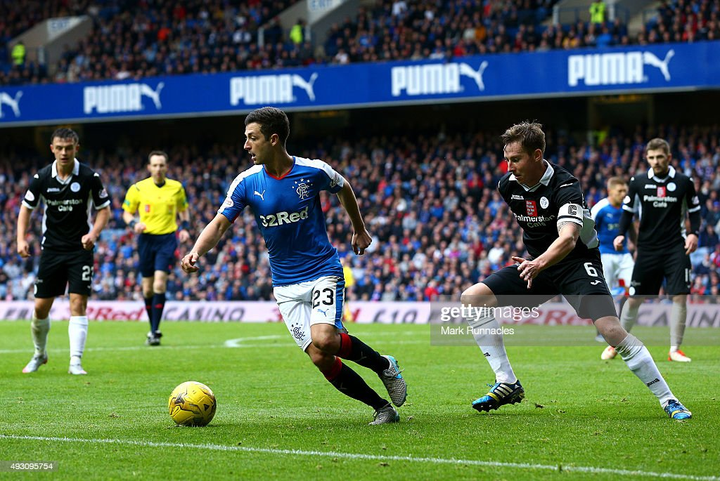 Jason Holt of Rangers is tracked by Christopher Higgins of Queen of the South during the Scottish Championship match between Glasgow Rangers FC and Queen of the South FC at Ibrox Stadium on October 17, 2015 in Glasgow, Scotland.