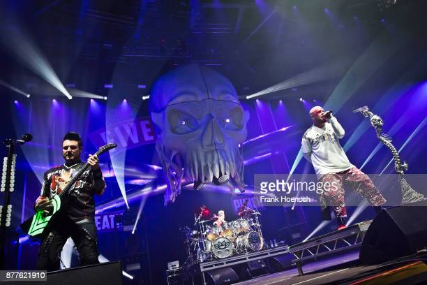 Jason Hook and Ivan Moody of the American band Five Finger Death Punch perform live on stage during a concert at the Velodrom on November 22 2017 in...