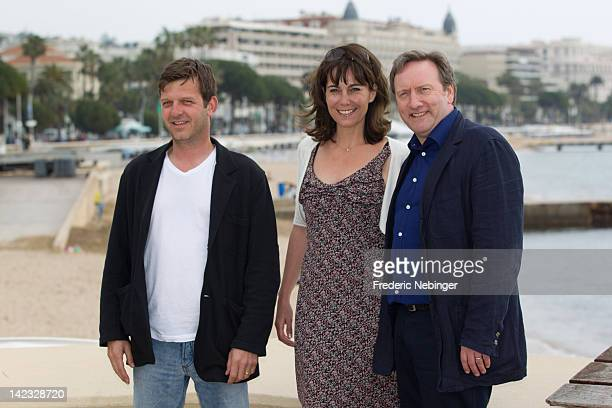 Jason Hughes Fiona Dolman and Neil Dudgeon attend a photocall for 'Midsomer Murders' as part of MIP TV 2012 at Majestic Beach on April 2 2012 in...