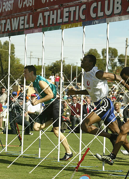 The stawell gift jason hunt of barbados 2nd r in the white wins the negle Image collections