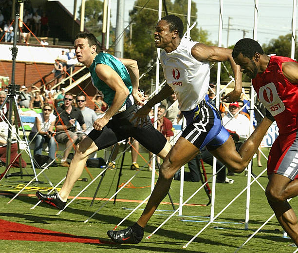The stawell gift jason hunt of barbados c in the white wins the 2004 australia negle Image collections