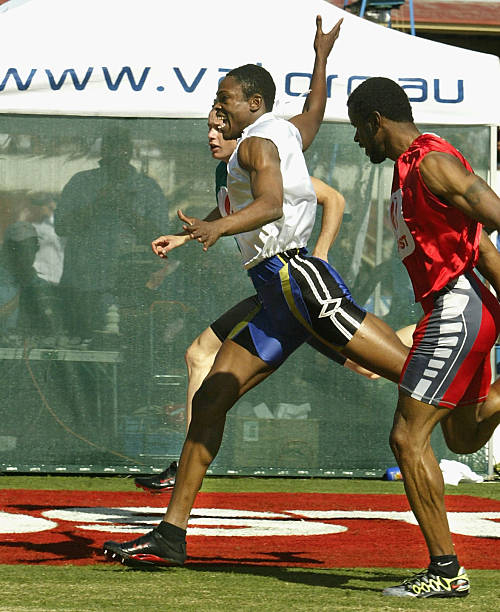 The stawell gift photos and images getty images jason hunt of barbados c in the white wins the 2004 australia negle Choice Image