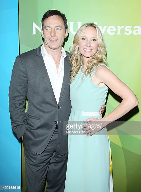 Jason Isaacs and Anne Heche arrive at the 2014 Television Critics Association Summer Press Tour - NBCUniversal - Day 2 held at The Beverly Hilton...