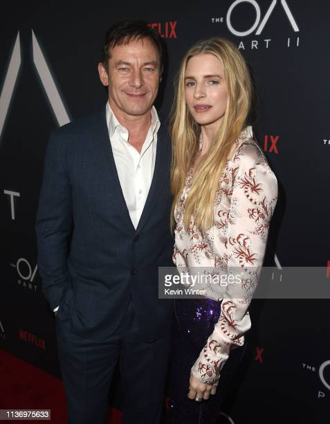 """Jason Isaacs and Brit Marling arrive at the premiere of Netflix's """"The OA Part II"""" at LACMA on March 19, 2019 in Los Angeles, California."""