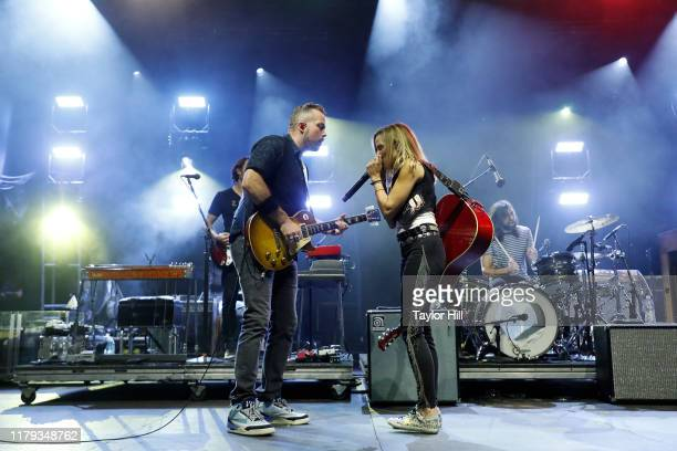 Jason Isbell and Sheryl Crow perform during the inaugural Shoals Fest at McFarland Park on October 05 2019 in Florence Alabama