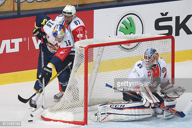 Jason Jaffray of Munich, Robert Rosen and Victor Andren of Vaxjo during the Champions Hockey League Round of 32 match between Red Bull Munich and...