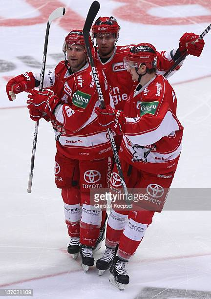 Jason Jaspers of Koelner Haie celebrates the seconRene Toft Hansegnoal with Alexander Weiss and Torsten Ankert during the DEL match between Koelner...