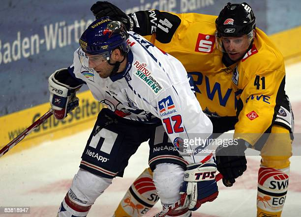Jason Jaspers of Mannheim is attcked by Jean Francois Fortin of Krefeld during the DEL match between Adler Mannheim and Krefeld Pinguine at the SAP...