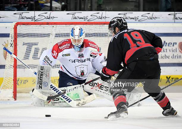 Jason Jaspers of the Thomas Sabo Ice Tigers Nuernberg shoots during the game between Thomas Sabo Ice Tigers and Eisbaeren Berlin on november 23, 2014...
