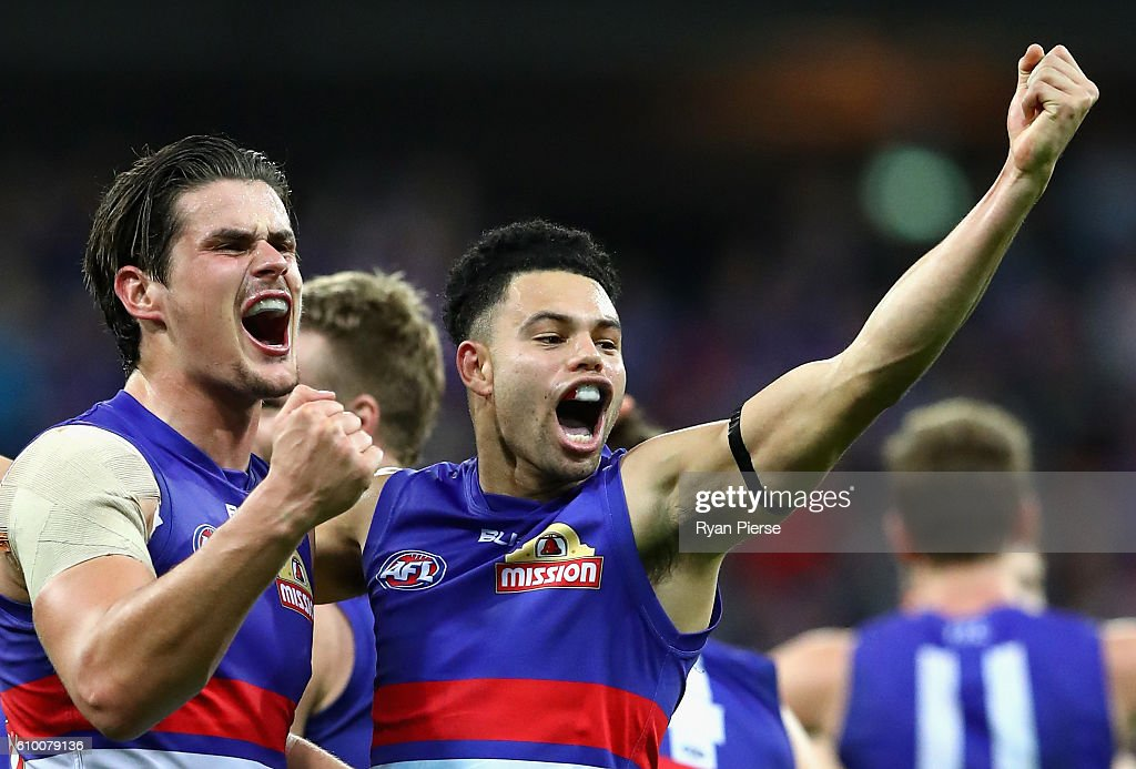 Jason Johannisen and Tom Boyd of the Bulldogs celebrate victory during the AFL First Preliminary Final match between the Greater Western Sydney Giants and the Western Bulldogs at Spotless Stadium on September 24, 2016 in Sydney, Australia.