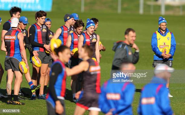 Jason Johannisen of the Bulldogs and his teammates look on during a Western Bulldogs AFL training session at Whitten Oval on June 23 2017 in...