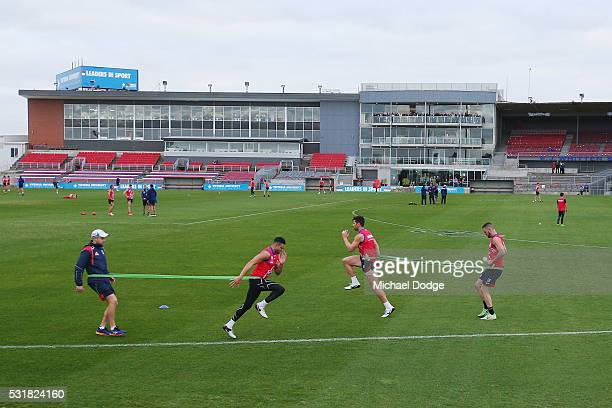 Jason Johannisen of the Bulldogs and Marcus Adams run with resistance bands during a Western Bulldogs AFL training session at Whitten Oval on May 17...