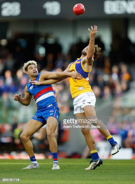 Jason Johannisen of the Bulldogs and Mark Hutchings of the Eagles compete for the ball during the 2017 AFL round 15 match between the Western...
