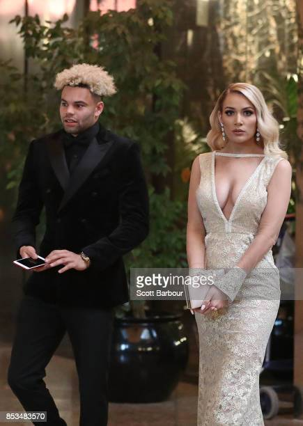 Jason Johannisen of the Bulldogs and partner Logan Shine arrive ahead of the 2017 Brownlow Medal at Crown Entertainment Complex on September 25 2017...
