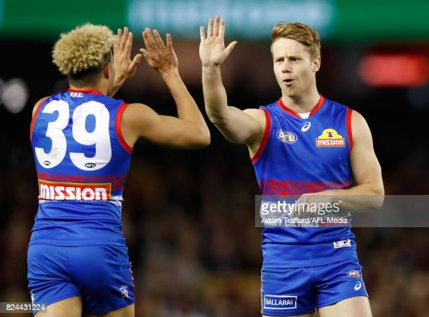 Jason Johannisen of the Bulldogs celebrates a goal with Lachie Hunter of the Bulldogs during the 2017 AFL round 19 match between the Western Bulldogs...