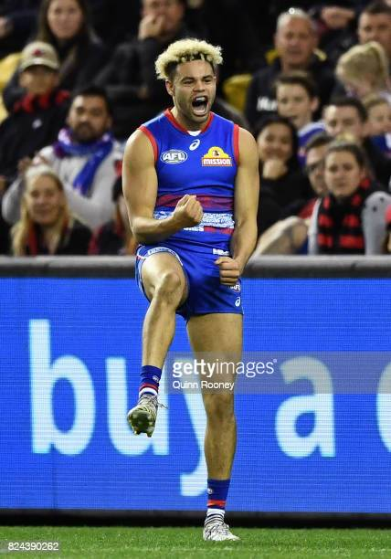 Jason Johannisen of the Bulldogs celebrates kicking a goal during the round 19 AFL match between the Western Bulldogs and the Essendon Bombers at...