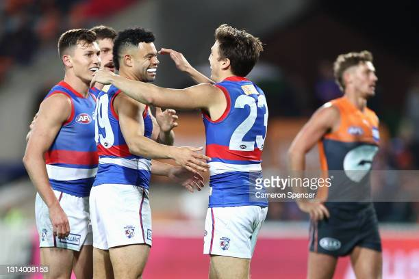 Jason Johannisen of the Bulldogs celebrates kicking a goal with team mates during the round six AFL match between the Greater Western Sydney Giants...