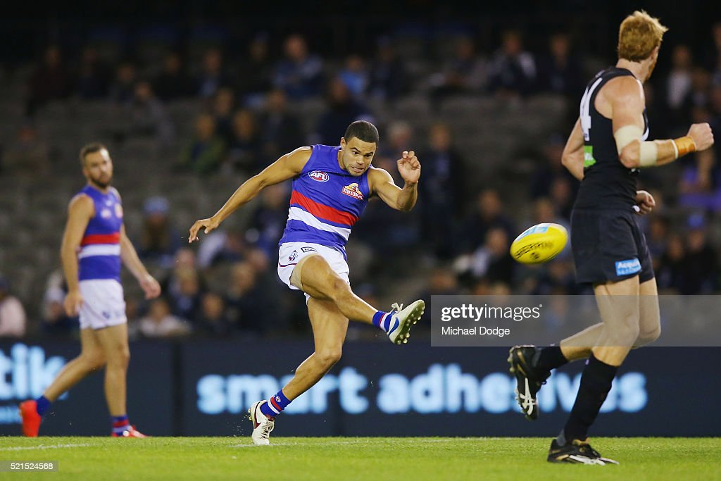 Jason Johannisen of the Bulldogs injures his hamstring after he kicks the ball for a goal during AFL Round 4 match between the Carlton Blues and the Western Bulldogs at Etihad Stadium on April 16, 2016 in Melbourne, Australia.