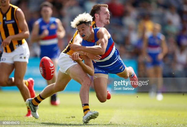 Jason Johannisen of the Bulldogs is tackled during the AFL JLT Community Series match between the Western Bulldogs and the Hawthorn Hawks at Mars...