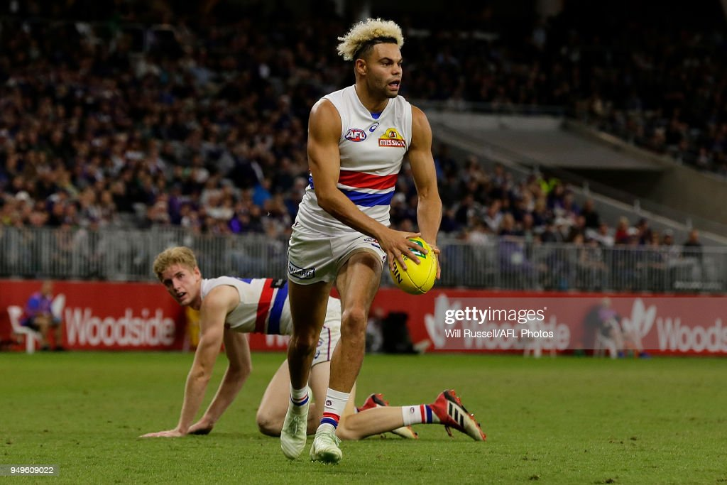 Jason Johannisen of the Bulldogs looks to pass the ball during the round five AFL match between the Fremantle Dockers and the Western Bulldogs at Optus Stadium on April 21, 2018 in Perth, Australia.