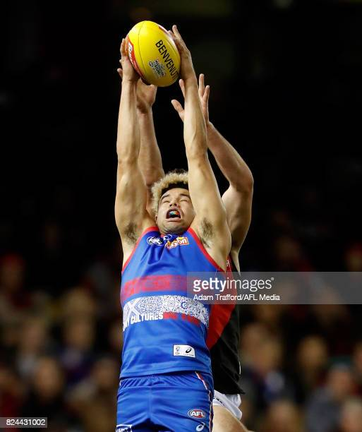 Jason Johannisen of the Bulldogs marks the ball over Conor McKenna of the Bombers during the 2017 AFL round 19 match between the Western Bulldogs and...