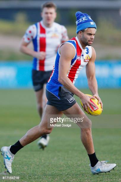 Jason Johannisen runs with the ball during a Western Bulldogs AFL training session at Whitten Oval on July 18 2017 in Melbourne Australia