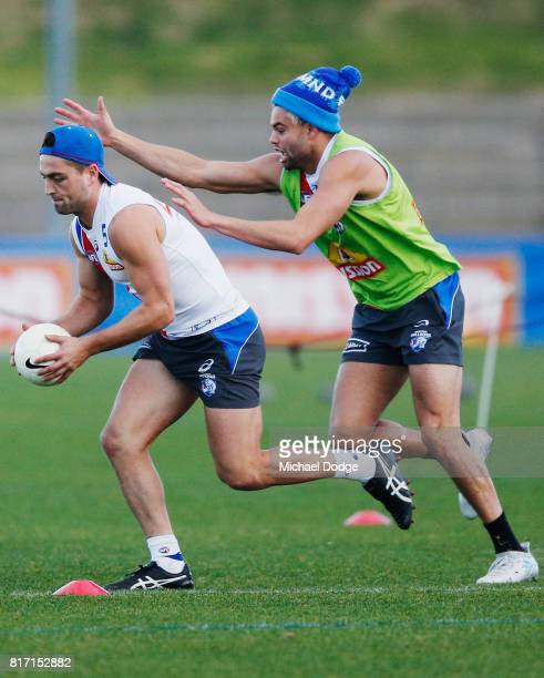 Jason Johannisen tackles Luke Dahlhaus during a Western Bulldogs AFL training session at Whitten Oval on July 18 2017 in Melbourne Australia
