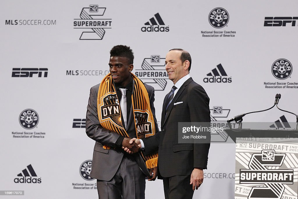 Jason Johnson of VCU shakes hands with commissioner Don Garber after being selected by the Houston Dynamo as the 13th overall pick in the 2013 MLS SuperDraft Presented by Adidas at the Indiana Convention Center on January 17, 2013 in Indianapolis, Indiana.