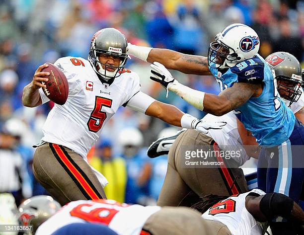 Jason Jones of the Tennessee Titans pressures quarterback Josh Freeman of the Tampa Bay Buccaneers during play at LP Field on November 27 2011 in...