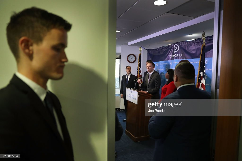 Jason Kander, president of Let America Vote speaks as Rep. Joaquin Castro, (D-TX) (L) and Rep. Terri Sewell (D-AL) (R) listen during a press conference held at the Democratic National Headquarters on July 19, 2017 in Washington, DC. The news conference was held 'to explain why the Trump administration's voter fraud commission was set up from the start to mislead the public and the steps that Democrats will take to fight back.