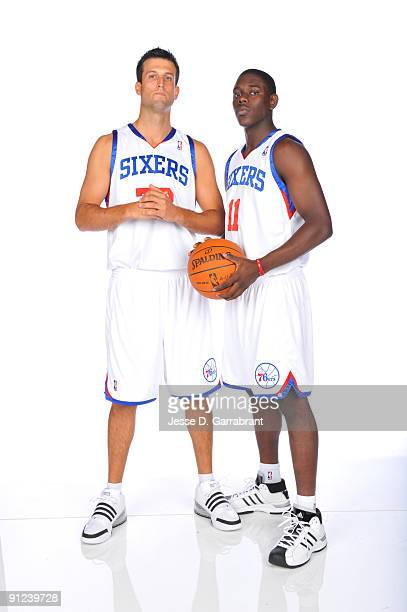 Jason Kapono and Jrue Holiday of the Philadelphia 76ers pose for a portrait during 2009 NBA Media Day on September 28 2009 at the Wachovia Center in...