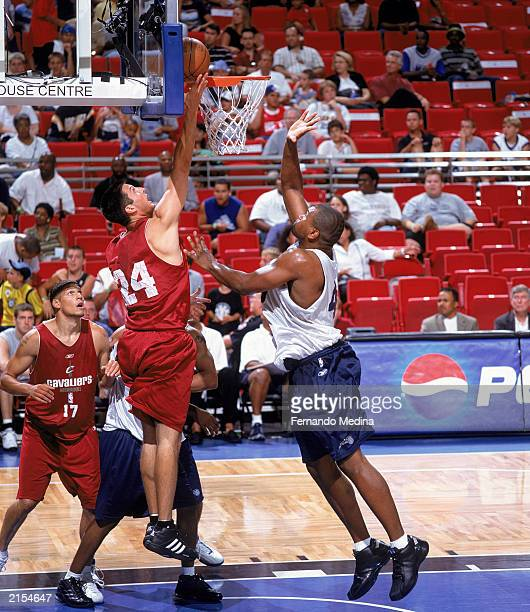 Jason Kapono of the Cleveland Cavaliers lays up the shot against Alton Ford of the Orlando Magic during the 2003 Pro Summer League game at TD...