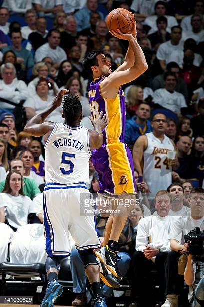 Jason Kapono of the Los Angeles Lakers shoots against Martell Webster of the Minnesota Timberwolves on March 9 2012 at Target Center in Minneapolis...