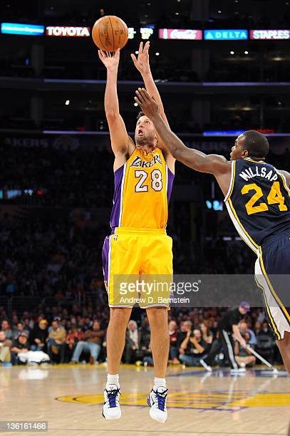 Jason Kapono of the Los Angeles Lakers shoots the jumper against Paul Millsap of the Utah Jazz at Staples Center on December 27 2011 in Los Angeles...