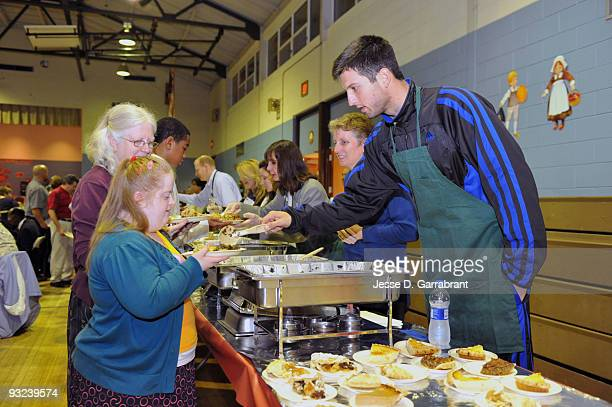 Jason Kapono of the Philadelphia 76ers serves food during a Thanksgiving event on November 19 2009 at The Children's Home in Mount Holly New Jersey...
