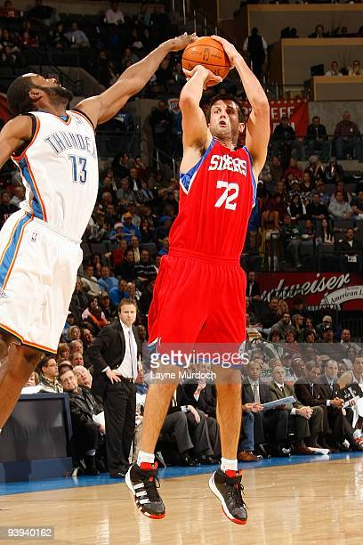 Jason Kapono of the Philadelphia 76ers shoots under pressure against James Harden of the Oklahoma City Thunder during the game on December 2 2009 at...