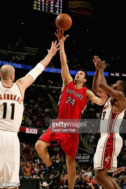 Jason Kapono of the Toronto Raptors puts a shot up over Zydrunas Ilgauskas and Damon Jones of the Cleveland Cavaliers during the game on March 21,...