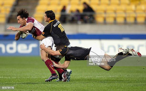 Jason Kawau of Southland is tackled by Piri Weepu and Shaun Treeby of Wellington during the Air New Zealand Cup Semi Final match between Wellington...