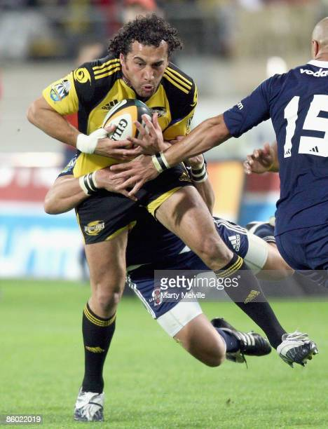 Jason Kawau of the Hurricanes is tackled during the round 10 Super 14 match between the Hurricanes and the Stormers at Westpac Stadium on April 18,...
