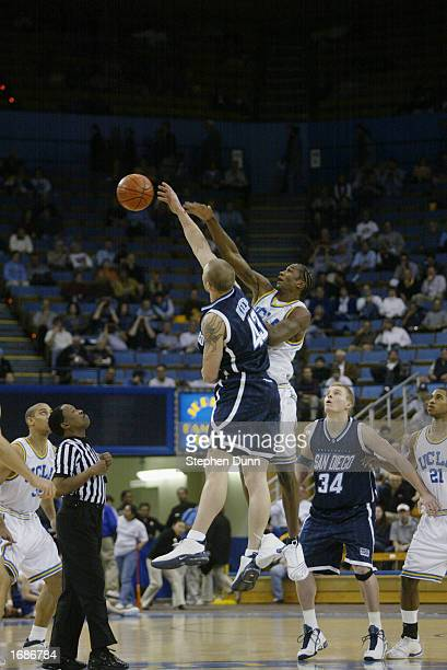 Jason Keep of the University of San Diego Toreros wins the tip over TJ Cummings of the UCLA Bruins during the NCAA basketball game at Pauley Pavilion...