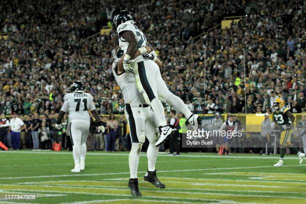 Jason Kelce and Jordan Howard of the Philadelphia Eagles celebrate after Howard scored a touchdown in the second quarter against the Green Bay...