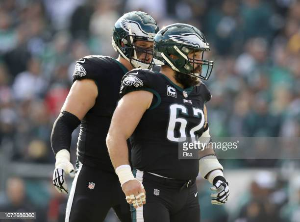 Jason Kelce of the Philadelphia Eagles is consoled by teammate Lane Johnson after Kelce is called for a penalty in the first half against the New...