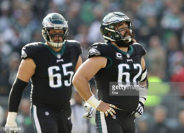 Jason Kelce of the Philadelphia Eagles reacts after he is called for a penalty as teammate Lane Johnson of the Philadelphia Eagles looks on in the...
