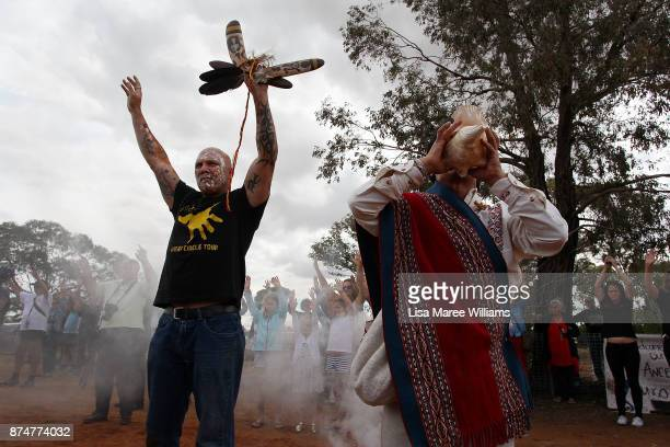 Jason Kelly of the Mutthi Mutthi Mob raises his hands welcoming Mungo Man back to country during a ceremony on November 16 2017 in Balranald...