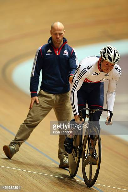 Jason Kenny of Great Britain and coach Jan van Eijden practice standing starts during a team GB training session at Manchester Velodrome on November...