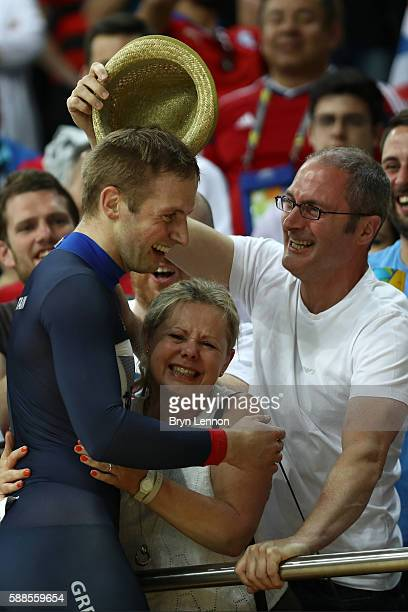 Jason Kenny of Great Britain celebrates after winning gold and getting an Olympic record in the Men's Team Sprint Track Cycling Finals on Day 6 of...