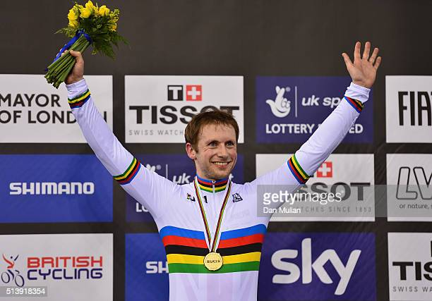 Jason Kenny of Great Britain celebrates on the medal podium after winning the Men's Sprint Final during Day Four of the UCI Track Cycling World...